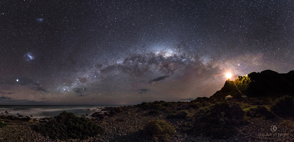 Winning image of the Astronomy Photographer of the Year 2013. I recently spent a night out at Cape Palliser on the North Island of New Zealand photographing the night sky. I awoke after a few hours sleep at 5am to see the Milky Way low in the sky above Cape Palliser. The only problem was my camera gear was at the top of the lighthouse as seen in the right of this image. I had set up a time-lapse there a few hours before, so I had to climb the 250 plus steps up there to retrieve my gear before I could take this photo. By the time I got back the sky was beginning to get lighter with sunrise 2 hours away. I took a 360 degree pano, with this being crop of around 180 degrees of that.